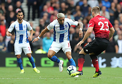 Brighton & Hove Albion's Anthony Knockaert (left) and Manchester United's Luke Shaw (right) battle for the ball during the Premier League match at the AMEX Stadium, Brighton.