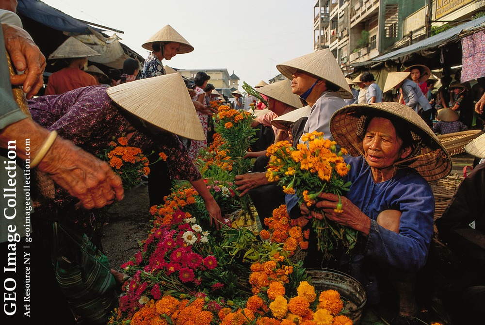 Viivd marigolds for Tet New Year celebration fill the market at Cantho, the largest town in the Mekong Delta, Vietnam.