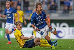 Frederik Gytkjær (Lyngby Boldklub) sparkes ned af Jesper Bøge (Hobro IK) under kampen i 3F Superligaen mellem Lyngby Boldklub og Hobro IK den 20. juli 2020 på Lyngby Stadion (Foto: Claus Birch).