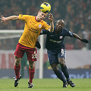 Galatasaray's Semih Kaya (L) and IBBSpor's Pierre Achille Webo Kouamo (R) during their Turkish Super League soccer match Galatasaray between IBBSpor at the TT Arena at Seyrantepe in Istanbul Turkey on Tuesday, 03 January 2012. Photo by TURKPIX