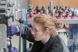 Young female engineer operating lever in an industrial plant, Freiburg im Breisgau, Baden-W¸rttemberg, Germany