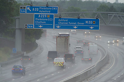 © Licensed to London News Pictures 18/06/2021. Aylesford, UK. Dangerous driving for motorists on a wet M20 near Maidstone. Torrential rain is causing roads to flood in Kent as thunderstorms are set to hit the UK again today. Photo credit:Grant Falvey/LNP