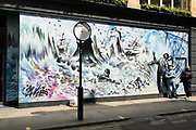 Berwick Street art mural in Soho on 26th May 2021 in London, United Kingdom. As the coronavirus lockdown continues its process of easing restrictions, more and more people are coming to the West End as more businesses open.