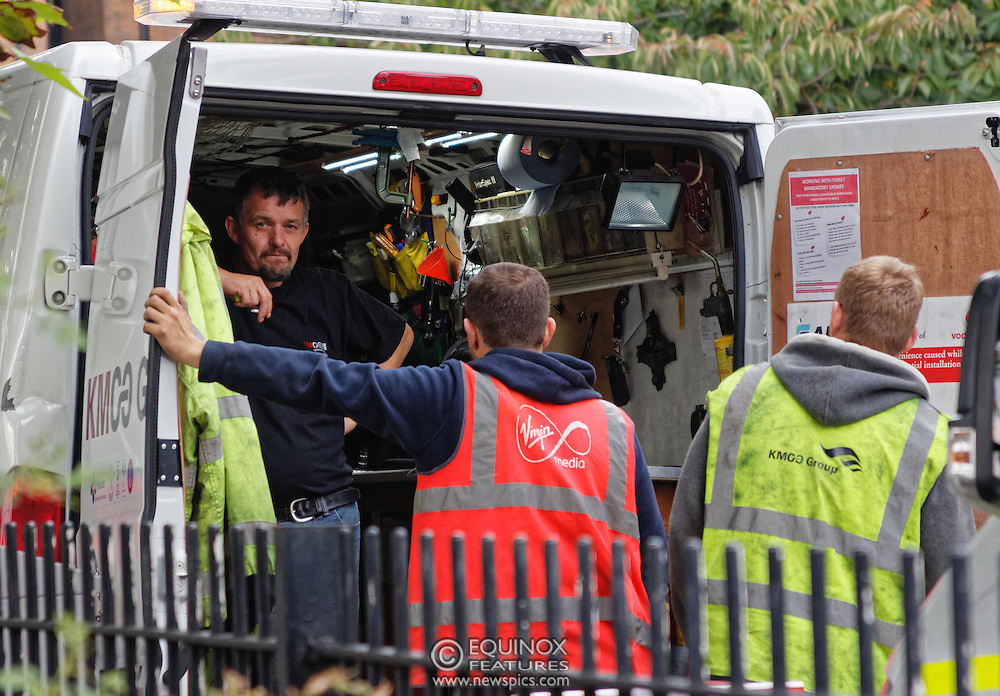 London, United Kingdom - 10 October 2015<br /> Huge drill cuts Virgin fiber cable. Thousand customers without weekend TV and internet. Severed fiber optic cables have caused up to a thousand customers of Virgin Media in Shoreditch and Hackney in London to be left without broadband internet and cable television this weekend. Engineers believe the total loss of service, which continues to be down this Saturday evening, is unlikely to be fixed until Sunday lunchtime at the earliest. The damage to a primary cable carrying 96 fiber optic cables including some belonging to the EE mobile network was caused by a huge drilling rig on a nearby construction site for a block of flats being built by Formation Construction Ltd. An engineer working on the drilling site claimed they had not 'drilled through the cable'. 'We damaged the cable' he said. He then demanded we delete images of the offending drilling rig. Technicians working on behalf of Virgin Media were working hard to replace the damaged cables. Virgin Media press office did not respond to repeated requests to speak with them for comment today.<br /> (photo by: EQUINOXFEATURES.COM)<br /> <br /> Picture Data:<br /> Photographer: Equinox Features<br /> Copyright: ©2015 Equinox Licensing Ltd. +448700 780000<br /> Contact: Equinox Features<br /> Date Taken: 20151010<br /> Time Taken: 17100144<br /> www.newspics.com