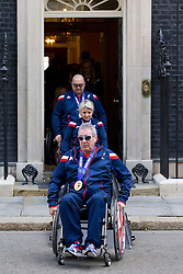 © Licensed to London News Pictures. 18/03/2014. London, UK. Members of the British Paralympic team are seen leaving Number 10 Downing Street after a visit to meet the British Prime Minister David Cameron. Photo credit: Matt Cetti-Roberts/LNP