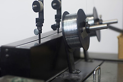 Part of printing Machinery with reel and silver threads