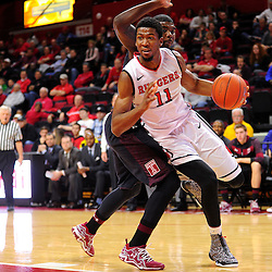 Kadeem Jack #11 of the Rutgers Scarlet Knights drives to the basket during the first half of Rutgers men's basketball vs Temple Owls in American Athletic Conference play on Jan. 1, 2014 at Rutgers Louis Brown Athletic Center in Piscataway, New Jersey.