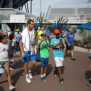 2017 U.S. Open - AUGUST 23.  Richard Gasquet of France with young fans as he heads to practice in preparation for The US Open Tennis Tournament at the USTA Billie Jean King National Tennis Center on August 23, 2017 in Flushing, Queens, New York City.  (Photo by Tim Clayton/Corbis via Getty Images)