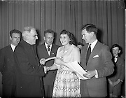 20/03/1959<br /> 03/20/1959<br /> 20 March 1959<br /> Gael Linn singing competition and concert at Dungannon, Co. Tyrone. <br /> Very Rev. Dean Quinn, P.P., Dungannon (left) presenting Miss Margaret Dynes, Church Street, Dungannon, with the 1st Prize of £10 in the Gael Linn Competition held in St. Patrick's Hall, Dungannon. Included are Seamus O'Gairbhshoin, Secretary of Dungannon Drama festival, and the National Organiser for Gael-Linn, Diarmuid O'Broin, (right).