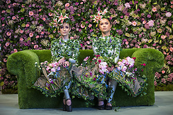 April 25, 2018 - Harrogate, Yorkshire, UK - Dancer ALISON PARSONS (left) & GEORGIA PATON DURRANT (right) wear flower dresses in living room of the Green House display at this years Harrogate Flower Show in which starts tomorrow.  The GREENhouse has been designed to blur the lines between house and garden, creating a home infused with nature complete with living wallpaper,cascading flower shower, an aromatic bed of herbs and even a vege-table. (Credit Image: © Andrew Mccaren/London News Pictures via ZUMA Wire)