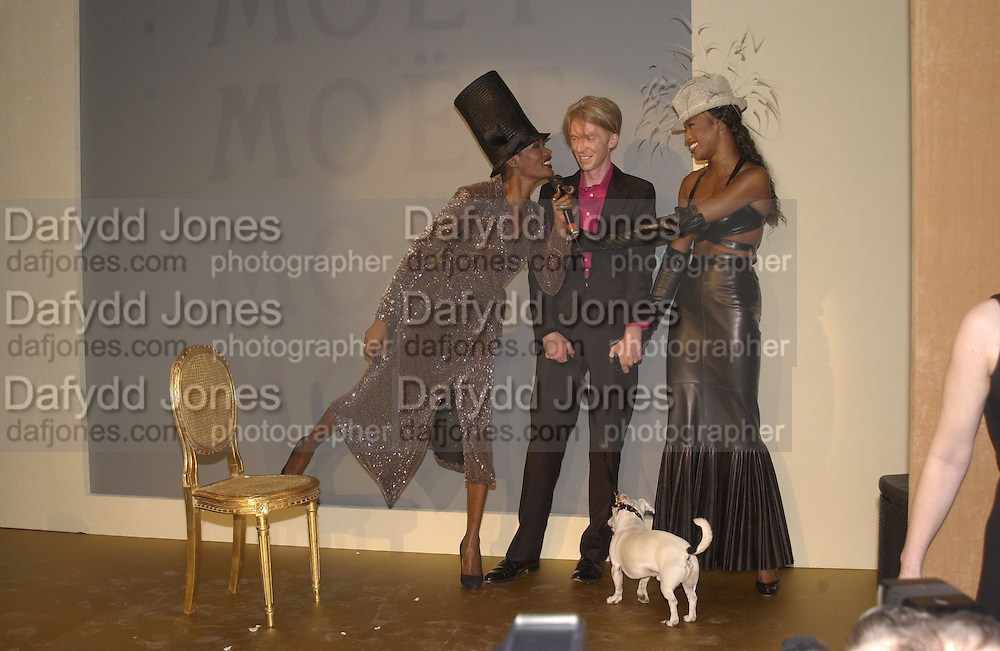 Grace Jones, Philip Treacy and Naomi Campbell. Moet and Chandon fashion tribute to Philip treacy. V. & a. 16 April 2002. © Copyright Photograph by Dafydd Jones 66 Stockwell Park Rd. London SW9 0DA Tel 020 7733 0108 www.dafjones.com