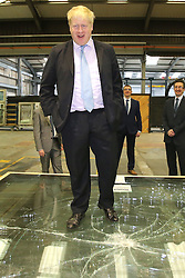 © Licensed to London News Pictures. 29/02/2016. Magherafelt, Northern Ireland, Mayor of London, Boris Johnson MP,tests a safety glass with his weight during a tour of Windell factory in Magherafelt,  Northern Ireland. Boris was visiting businesses that are supported by investment from Transport for London. Photo credit : Paul McErlane/LNP