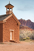 Adobe schoolhouse and Zion cliffs, Grafton ghost town, Utah USA