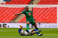 Cray Valley's Anthony Edgar (7) tackled by Chertsey Town's Lewis Driver (14) during the FA Vase final match between Chertsey Town and Cray Valley at Wembley Stadium, London, England on 19 May 2019.