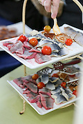 Pieces of Pickled herring fillet on a buffet table