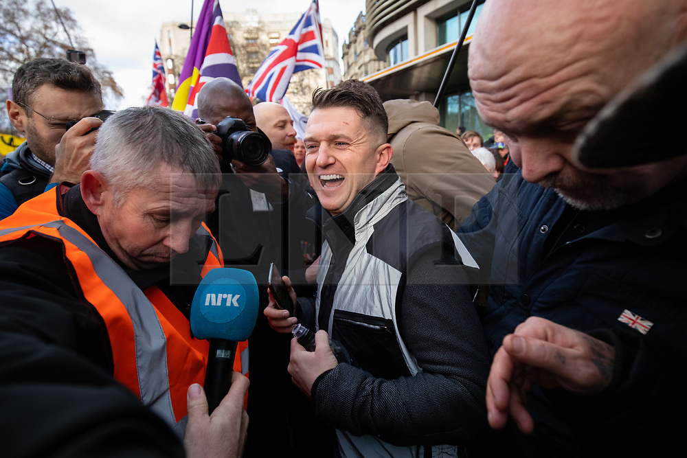 © Licensed to London News Pictures. 09/12/2018. London, UK. Political activist Stephen Yaxley-Lennon (centre), also known as Tommy Robinson takes part in a 'Brexit Betrayal' march in central London, campaigning against Theresa May's Brexit deal. A counter demonstration organised by Unite Against Fascism and Racism is also taking place on a different route.  Photo credit : Tom Nicholson/LNP