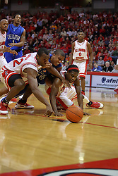 03 January 2009: Dinma Odiakosa, Kenny Lawson and Champ Oguchi dive for a loose ball. The Illinois State University Redbirds extended their record to 14-0 with a 86-64 win over the Creighton Bluejays on Doug Collins Court inside Redbird Arena on the campus of Illinois State University in Normal Illinois