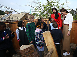 The Duchess of Cambridge speaks children during a visit to her garden at the RHS Chelsea Flower Show at the Royal Hospital Chelsea, London.