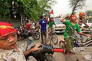 Children are part of the euphoria and aren't shy to walk down the streets to celebrate. Mandalay, Myanmar. 2012