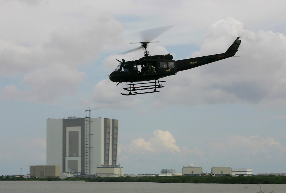 Space Shuttle Discovery launch, STS-121.A NASA security helicopter takes off after the launch attempt on July 1 was scrubbed because of bad weather in the area.