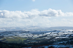 © Licensed to London News Pictures. 13/02/2014. Mynydd Epynt Uplands, Powys, wales, UK. A view towards The Btecon Beacons. Temperatures dropped below zero and a light dusting of snow fell last night on high land in Mid Wales and in The Brecon Beacons National Park. Hailstorms replaced snowfalls this morning. Photo credit : Graham M. Lawrence/LNP