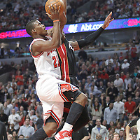 14 March 2012: Chicago Bulls guard Jimmy Butler (21) goes for the layup against Miami Heat center Joel Anthony (50) during the Chicago Bulls 106-102 victory over the Miami Heat at the United Center, Chicago, Illinois, USA.