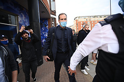 © Licensed to London News Pictures. 20/04/2021. London, UK. Chelsea performance advisor Petr Cech is given s police escort in to the ground as  Fans gather outside of Stamford Bridge in West London ahead of the Premiere League game between Chelsea and Brighton, to demonstrate against plans for a European Super League. There has been widespread hostility towards proposals for a new elite league of European football clubs, which opponents say will kill competition and damage the sport. Photo credit: Ben Cawthra/LNP