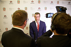 CARDIFF, WALES - Monday, October 5, 2015: Wales' Gareth Bale is interviewed by Rob Dowling for FAW TV after the FAW Awards Dinner at Cardiff City Hall. (Pic by David Rawcliffe/Propaganda)