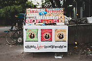 Mandalay, Myanmar - November 10, 2011: On a quiet street in downtown Mandalay, a cart displays a variety of condoms for sale