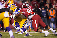 FAYETTEVILLE, AR - NOVEMBER 15:  Darius Philon #91 of the Arkansas Razorbacks tackles Terrence Magee #18 of the LSU Tigers at Razorback Stadium on November 15, 2014 in Fayetteville, Arkansas.  The Razorbacks defeated the Tigers 17-0.  (Photo by Wesley Hitt/Getty Images) *** Local Caption *** Darius Philon; Terrence Magee