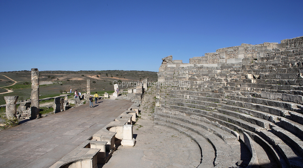 View from the side of Theatre, c. 40-60 AD, Segobriga, Spain, pictured on April 13, 2006, in the afternoon. Seating 2,000 people, the raked auditorium surrounds a semi-circular stage. The theatre was decorated with ornate columns and statues whose ruins remain. Segobriga was founded by the Romans in the 1st century BC, after the Punic wars, and the town was developed during the reign of  Augustus. It became an important administrative centre whose local industry was mining ëspecularis lapisí, a crystallized sheet gypsum used for window glass. Picture by Manuel Cohen.