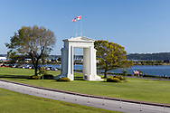 """The Peace Arch at the Peace Arch (Douglas) Border Crossing from Surrey British Columbia. The Peace Arch was built in 1921 and straddles the border between the United States and Canada.  The Peace Arch was built to commemorate the 100 year anniversary of treaties at the end of the War of 1812 between the USA and Great Britain. One side states """"Children Of A Common Mother"""", the other """"Brethren Dwelling Together In Unity"""".  Parks straddle the border as well, Peace Arch Provincial Park on the Canadian side, and Peace Arch Historical State Park on the Washington State side."""