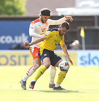 Oxford United's Jamie Hanson and Blackpool's Luke Garbutt<br /> <br /> Photographer Rob Newell/CameraSport<br /> <br /> Sky Bet League One Play-Off Semi-Final 1st Leg - Oxford United v Blackpool - Tuesday 18th May 2021 - Kassam Stadium - Oxford<br /> <br /> World Copyright © 2021 CameraSport. All rights reserved. 43 Linden Ave. Countesthorpe. Leicester. England. LE8 5PG - Tel: +44 (0) 116 277 4147 - admin@camerasport.com - www.camerasport.com