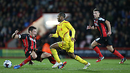 Liverpool striker Raheem Sterling goes round tommy Elphick during the Capital One Cup match between Bournemouth and Liverpool at the Goldsands Stadium, Bournemouth, England on 17 December 2014.