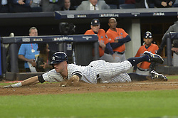 October 18, 2017 - Bronx, NY, USA - The New York Yankees' Brett Gardner slides home safely on a double by Aaron Judge in the third inning against the Houston Astros in Game 5 of the American League Championship Series at Yankee Stadium in New York on Wednesday, Oct. 18, 2017. (Credit Image: © Howard Simmons/TNS via ZUMA Wire)