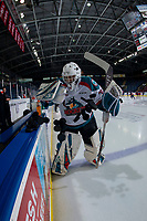 KELOWNA, CANADA - FEBRUARY 23:  Roman Basran #30 of the Kelowna Rockets clears the pucks to the ice at the start of warm up against the Kamloops Blazers on February 23, 2019 at Prospera Place in Kelowna, British Columbia, Canada.  (Photo by Marissa Baecker/Shoot the Breeze)