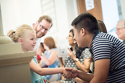 "1 July 2018, Geneva, Switzerland: 6-year old Heidi greets LWF Council member Johanan-Celine Valeriano. On Sunday, LWF Council members joined local congregants for Sunday service at the Evangelical Lutheran Church in Geneva. The 2018 LWF Council meeting takes place in Geneva from 27 June - 2 July. The theme of the Council  is ""Freely you have received, freely give"" (Matthew 10:8, NIV). The LWF Council meets yearly and is the highest authority of the LWF between assemblies. It consists of the President, the Chairperson of the Finance Committee, and 48 members from LWF member churches in seven regions."