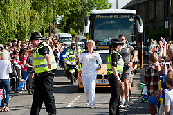 The Olympic Torch relay reaches Sheffield on day 38 coverage from the Chapeltown - Ecclesfield - Parson Cross section of the Journey.<br /> Runner 102 Joshua McGill brings the flame into chapeltown<br /> 25 June 2012.Image © Paul David Drabble