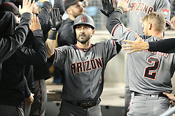 April 13, 2018 - Los Angeles, CA, U.S. - LOS ANGELES, CA - APRIL 13: Arizona Diamondbacks Infield Daniel Descalso (3) gets high fives in the dugout after his two run homer in the seventh inning in the game between the Arizona Diamondbacks and the Los Angeles Dodgers on April 13, 2018, at Dodger Stadium in Los Angeles, CA.(Photo by Peter Joneleit/Icon Sportswire) (Credit Image: © Peter Joneleit/Icon SMI via ZUMA Press)