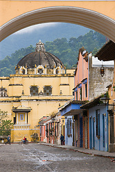 Street  scene beneath Arch of Santa Catalina, built to allow nuns to cross street from convent to convent, Antigua, Guatemala