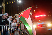 Protestors at The Palestine supporters march on the Israeli Consulate in New York City in attempt to end U.S. backed Israeli millitary assault on Hamas controlled Gaza Strip in Palestine held at The Israeli Consulate in NYC on December 30, 2008