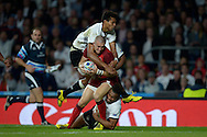 Mike Brown of England breaks past his tacklers Nikola Matawalu of Fiji and Ben Volavola of Fiji as he scores his 2nd try of the match. Rugby World Cup 2015 pool A match, England v Fiji at Twickenham Stadium in London on Friday 18th September 2015.<br /> pic by John Patrick Fletcher, Andrew Orchard sports photography.