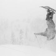 Tyler Hatcher backflips over the boundary line at Mount Baker Ski Area.