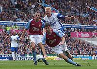 Credit: Back Page Images. Aston Villa v Crystal Palace, FA Premiership, 25/09/2004. Aki Riihilahti (Crystal Palace) Mark Delaney and Gavin McCann (Aston Villa)