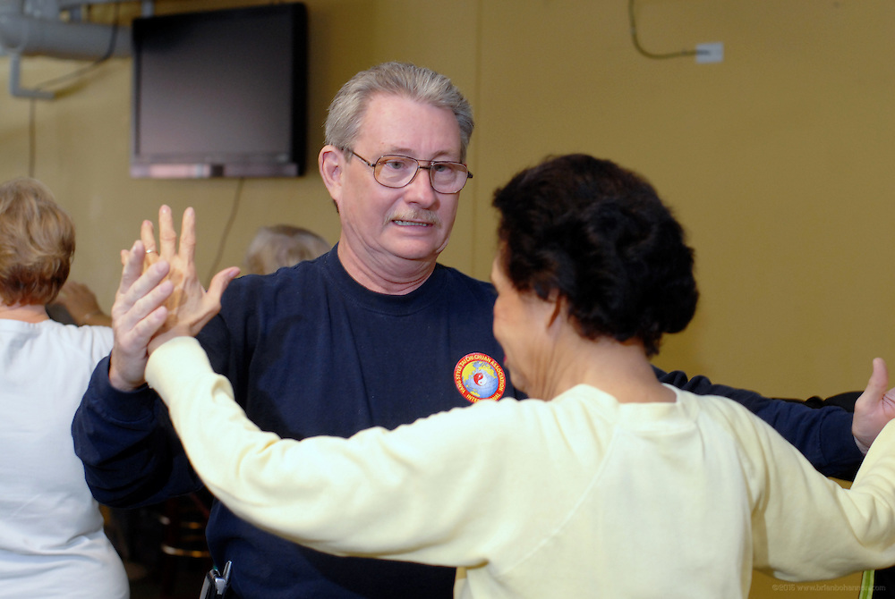 Instructor Jeffrey Graham corrects Gloria Marshall's form during the Highlands Community Ministry's Senior Services Tai Chi class Tuesday, March 11, 2008 in Louisville, Ky., at St Paul's Methodist Church. (AP Photo/Brian Bohannon)
