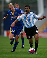 Photo: Steve Bond.<br /> Shrewsbury Town v Chesterfield. Coca Cola League 2. 13/10/2007.Jack Lester (R) nearly loses his shirt to Colin Murdock (L)