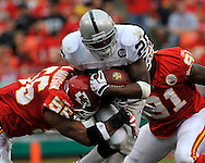 Running back Darren McFadden (20) of the Oakland Raiders gets tackled by linebacker Derrick Johnson (56) of the Kansas City Chiefs in the second quarter at Arrowhead Stadium in Kansas City, Missouri on September 14, 2008.....