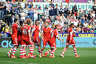Southampton's Rickie Lambert © celebrates with his teammates after he scores his sides 1st goal. Barclays Premier league match, Swansea city v Southampton at the Liberty stadium in Swansea, South Wales on Saturday 3rd May 2014.<br /> pic by Phil Rees, Andrew Orchard sports photography.