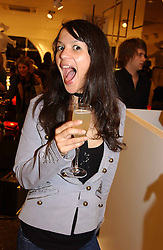 LISA MOORISH at a party to celebrate the opening of the new H&M Flagship Store at 17-21 Brompton Road, London SW3 on 23rd March 2005.<br />