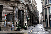 A pedestrian moves across a quiet Threadneedle Street during the third lockdown of the Coronavirus pandemic, in the 'City of London', the capital's financial district, aka The Square Mile, on 2nd February 2021, in London, England.